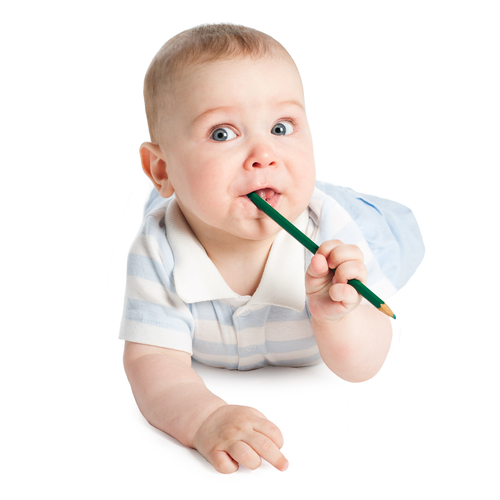 baby with pencil