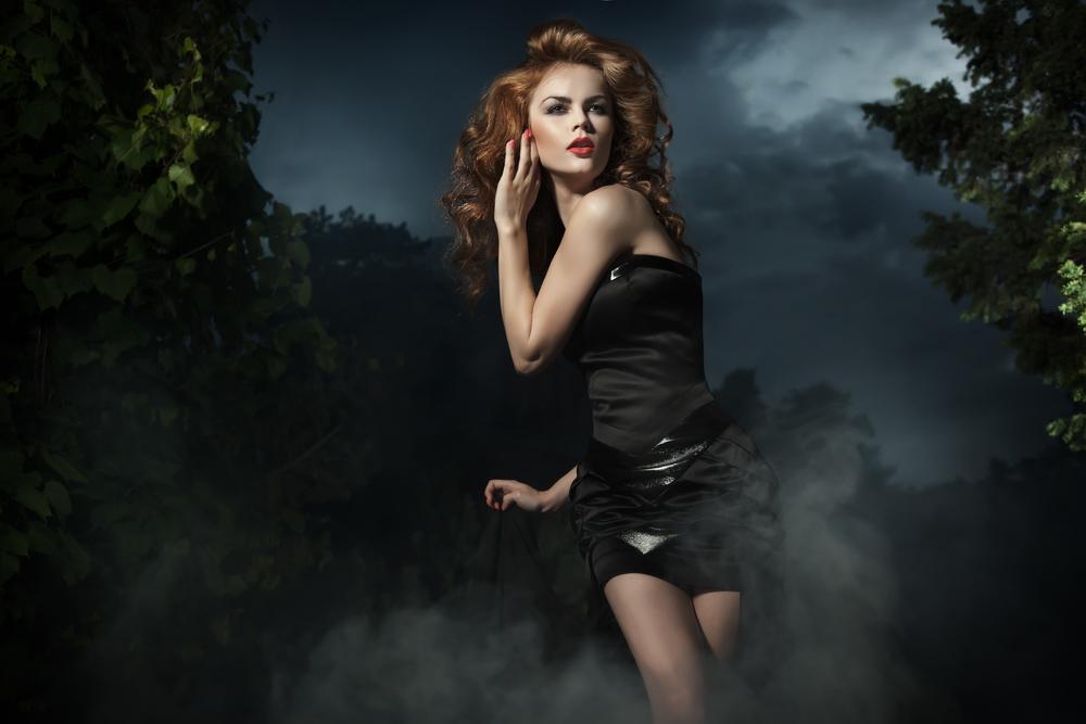 pretty woman running at night - fashion shoot