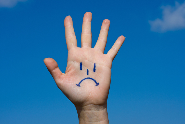 hand with a sad smile