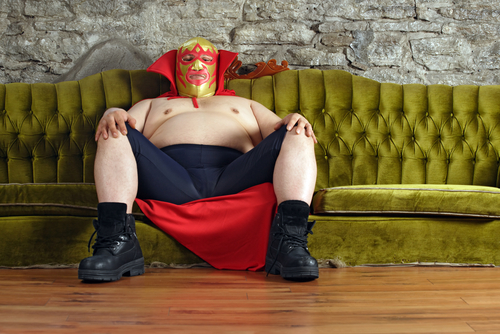 fat man with mask on sofa