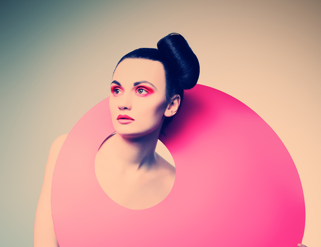 woman with pink circle