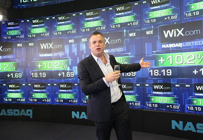 Wix' CEO, Avishai Abrahami, giving his presentation at NASDAQ
