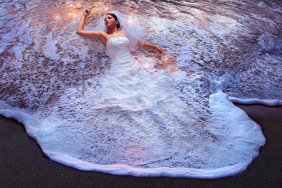 Bride takes a swim