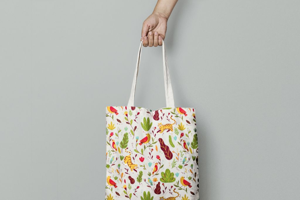 Patterned canvas tote bag with plants and animals