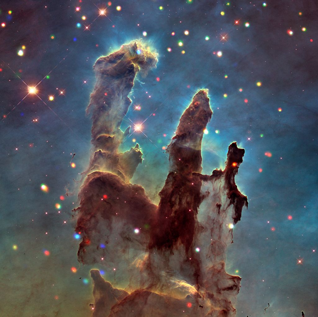 The Eagle Nebula and the Pillars of Creation by NASA