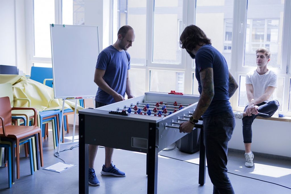 Playing table football at work in the office