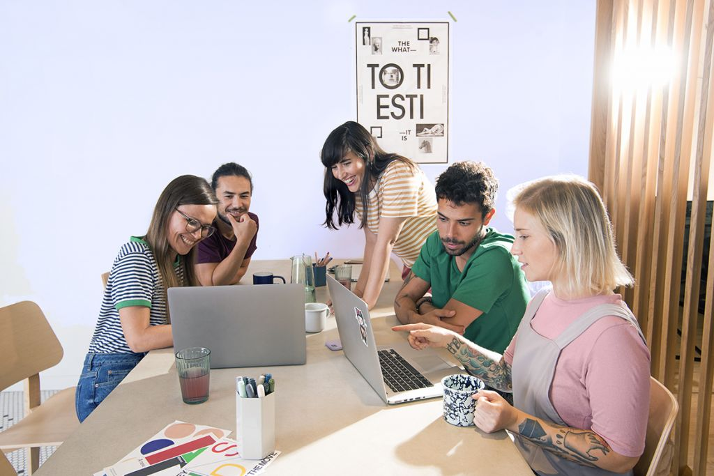 Working together in the office, positive work environment