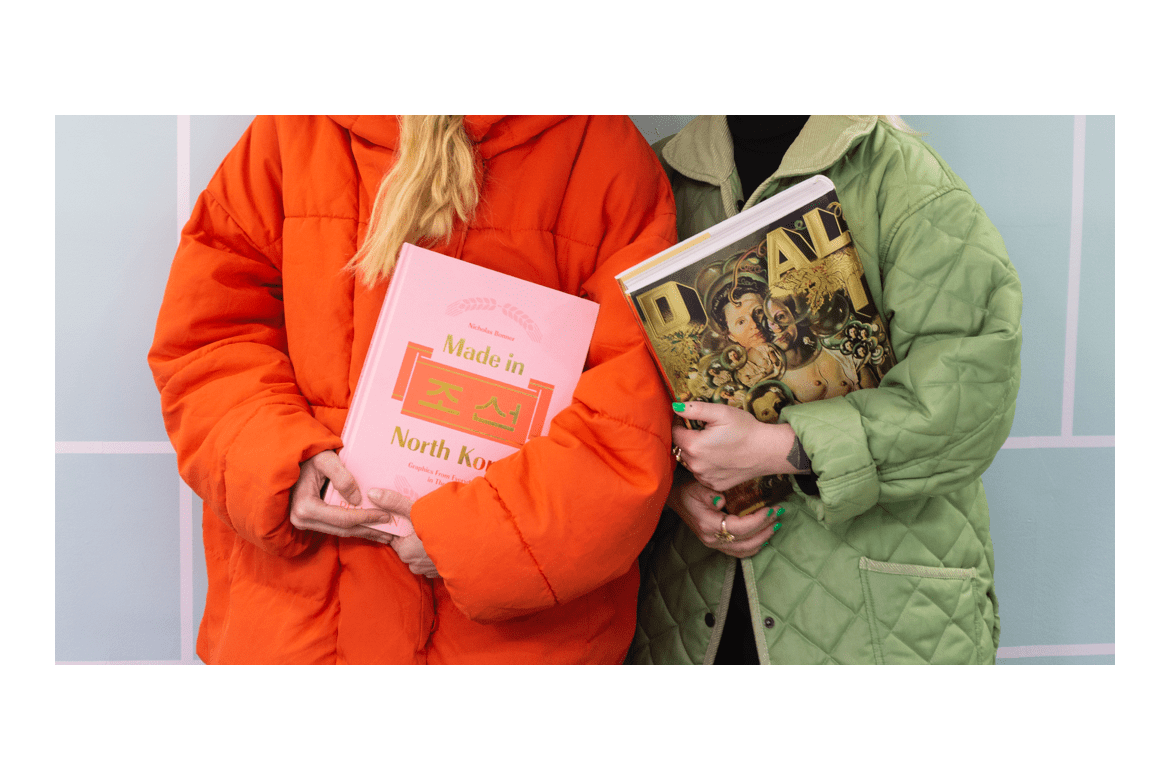 Two people holding art and design books