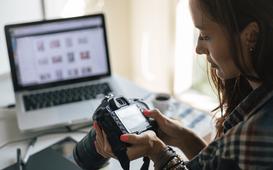 Young woman downloading images from camera to pc