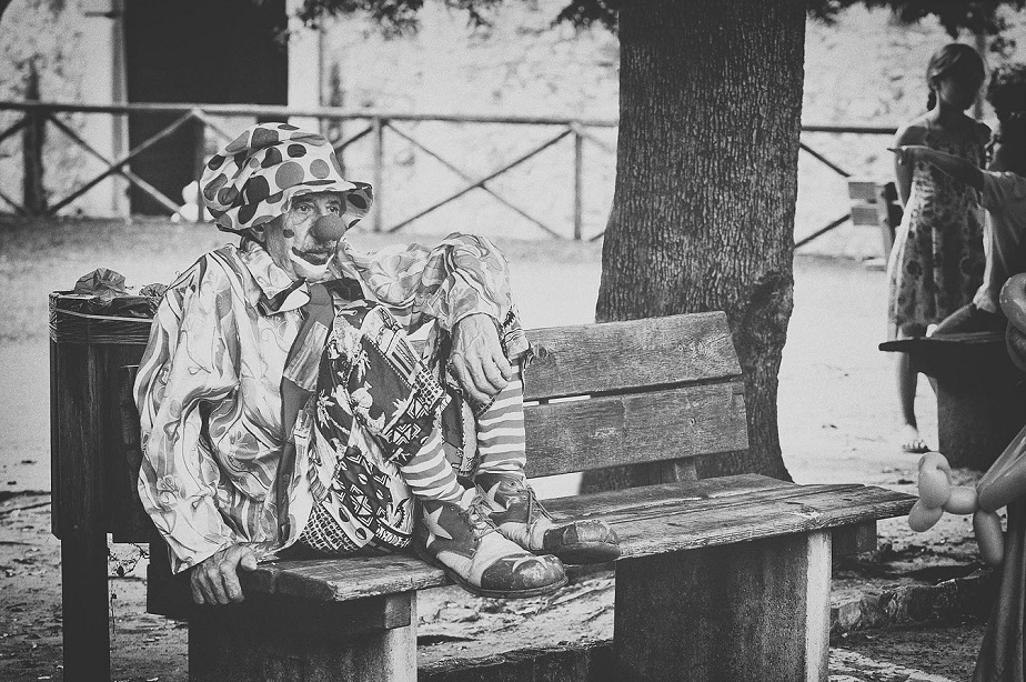 Clown on a Bench - Wix Photography