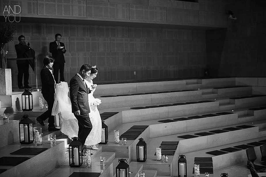 Bride walking down the aisle with her father by Wix Photographer Time and You