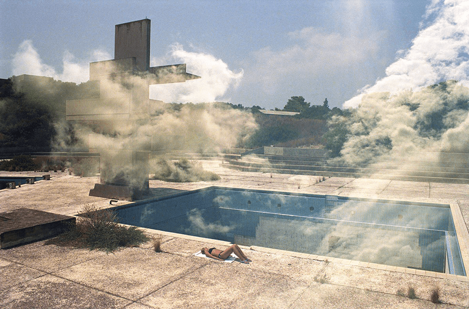 woman sunbathing in an abandoned pool
