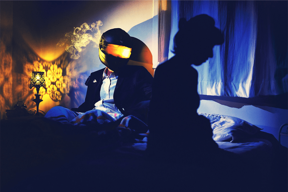 Surreal photo of man in bike helmet with lights thinking of a woman