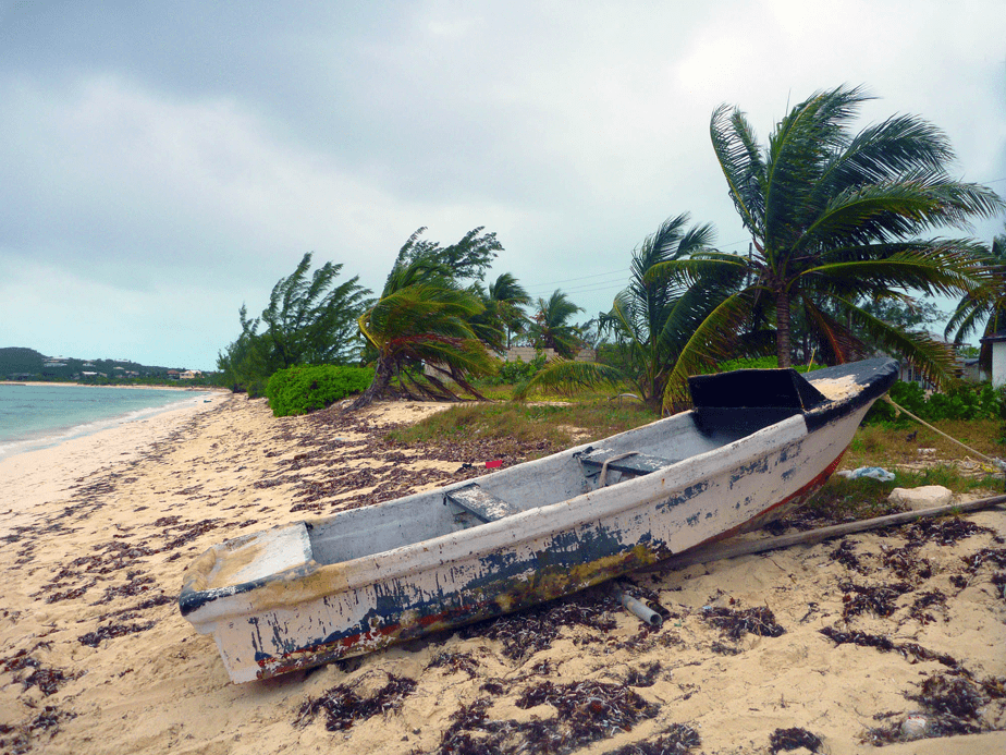 Deserted boat on a sandy island