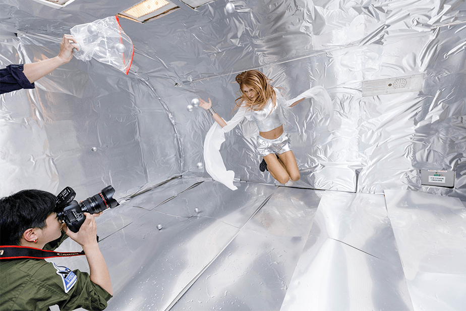 fashion photo shoot in zero gravity with water bubbles