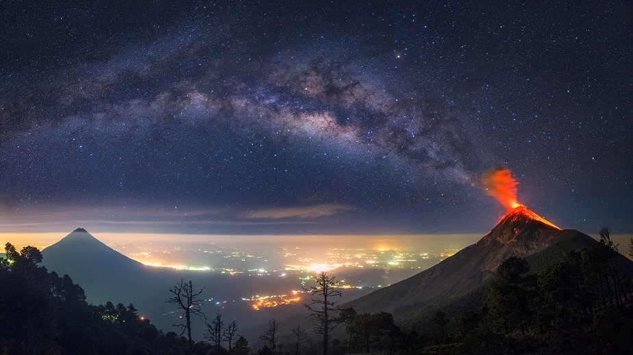 Erupting volcano with Milky Way by Wix landscape photographer Albert Dros