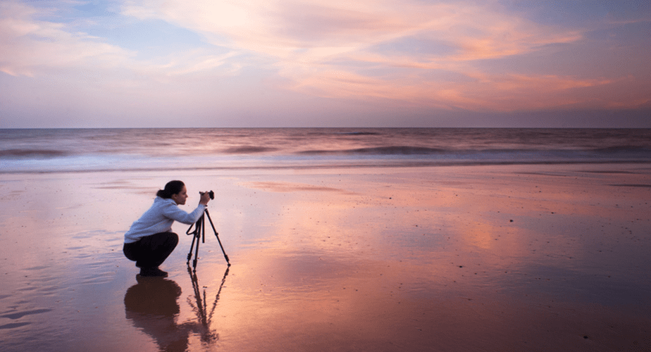 Photographer with tripod shooting the sunset