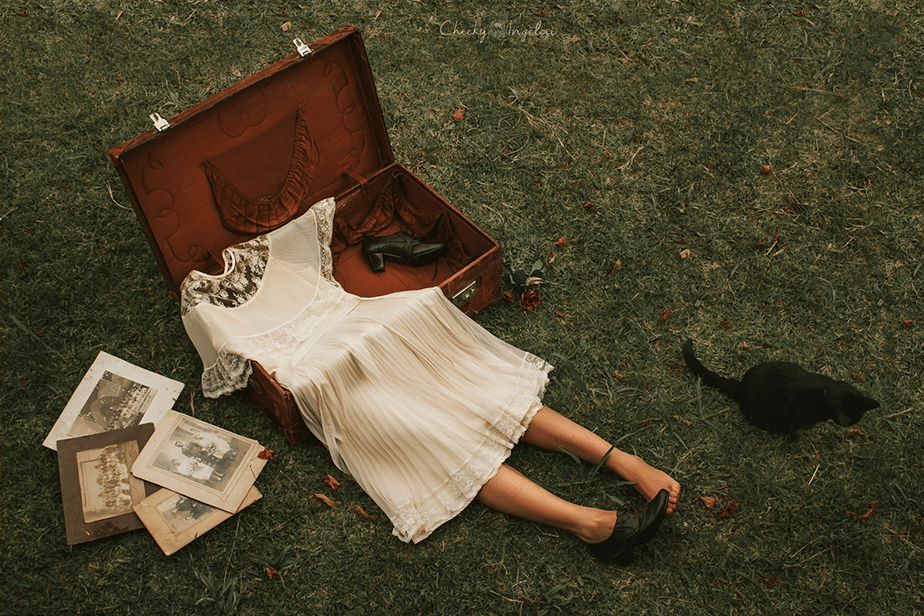 bride dress with legs in antique suitcase