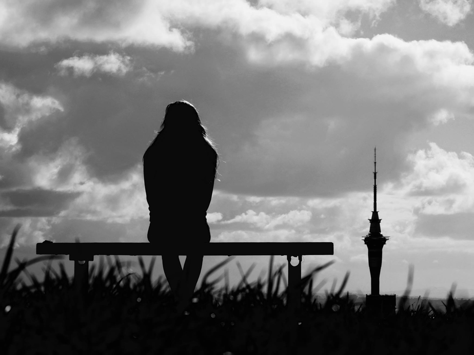 Woman's silhouette in front of Auckland's TV tower