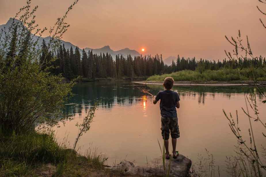 boy fishing in a beautiful landscape