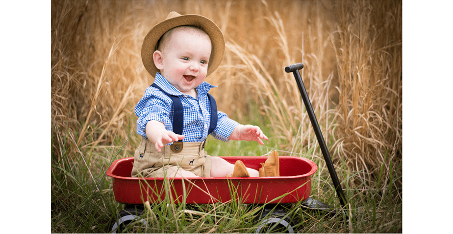 cute baby in a red wagon