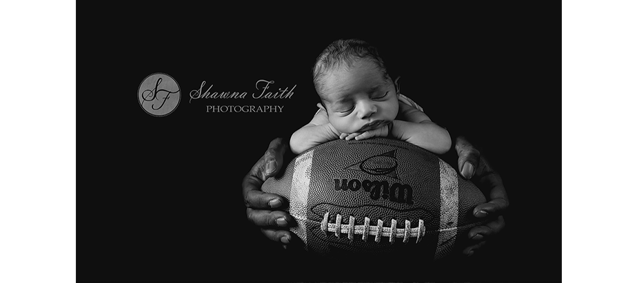 newborn photo with a football