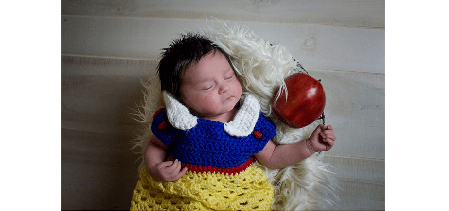 newborn dressed as the sleeping beauty