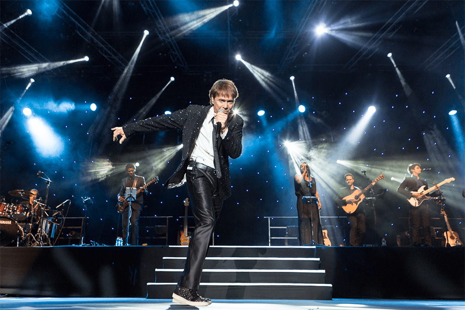 Cliff Richard dancing on stage