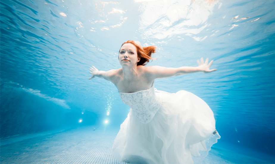 bride swimming underwater