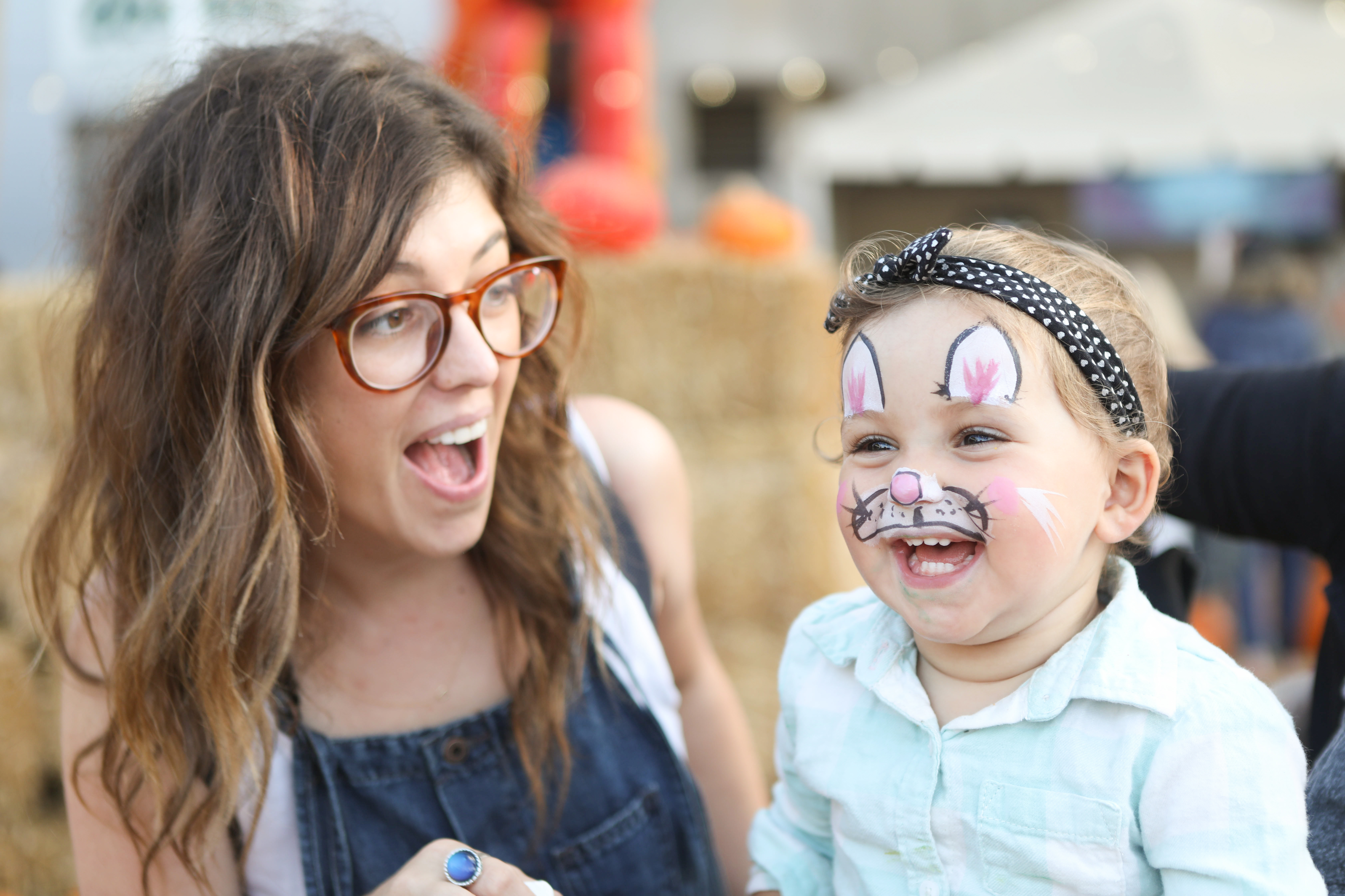 Young woman with child in cute makeup