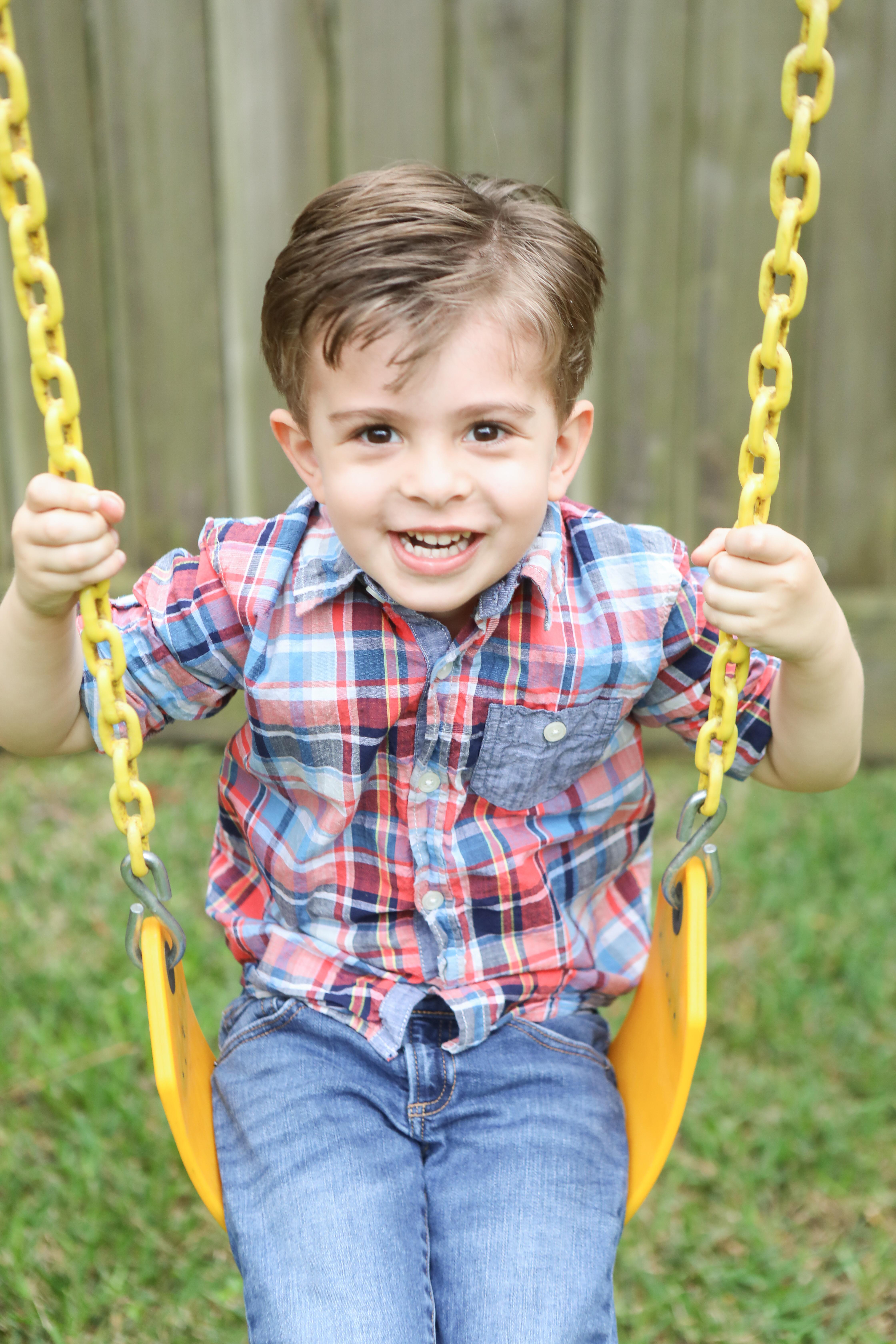 kid on a swing