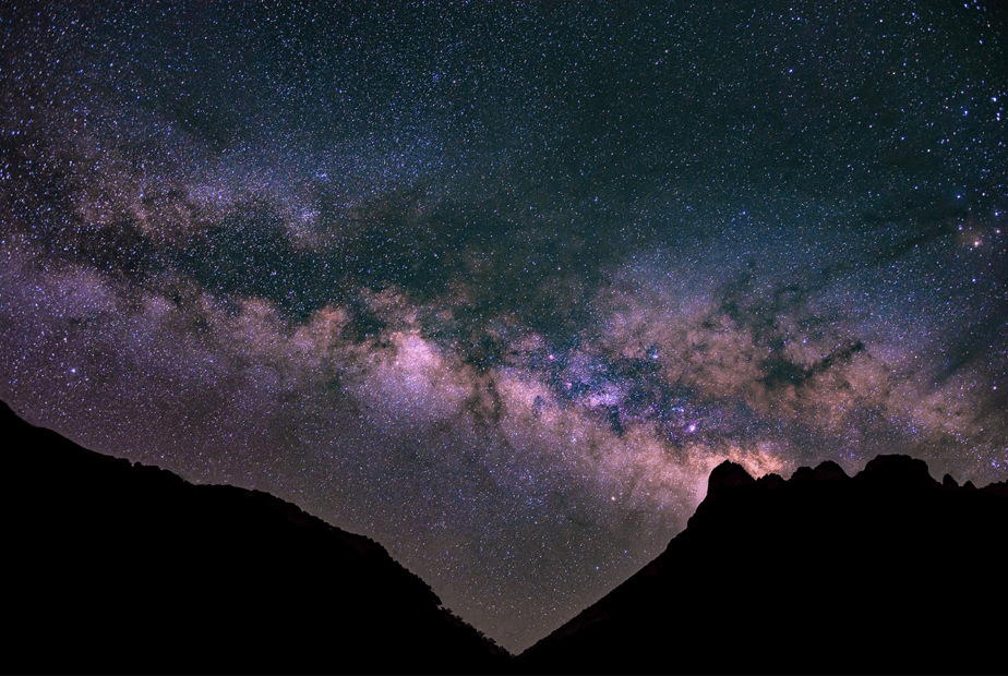 milky way and mountain silhouette