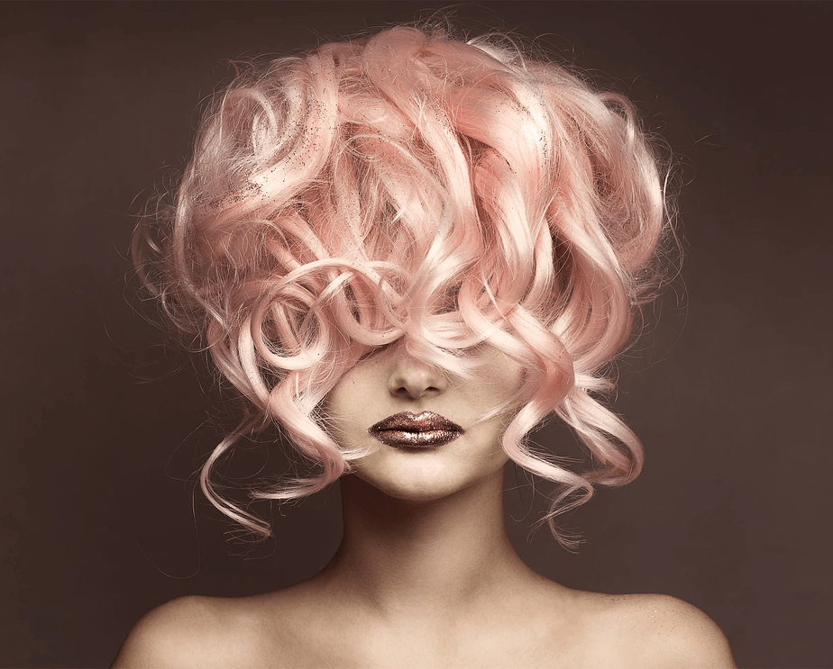 woman with large pink wig