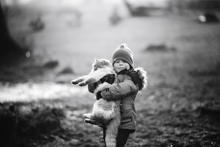cute boy holding a cat