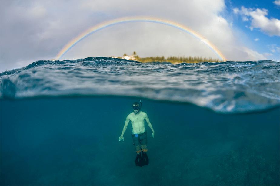 swimmer under a rainbow