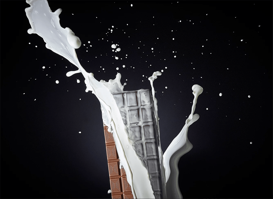 a splash of milk hitting a milk chocolate bar