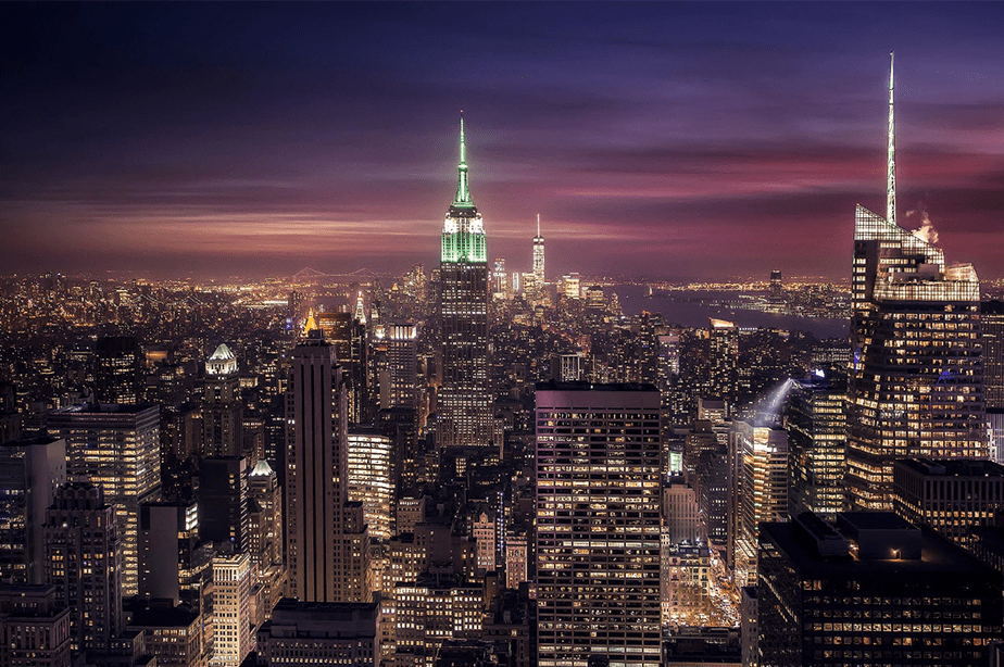 colorful sunset and night lights view from the top of the rock in new york city