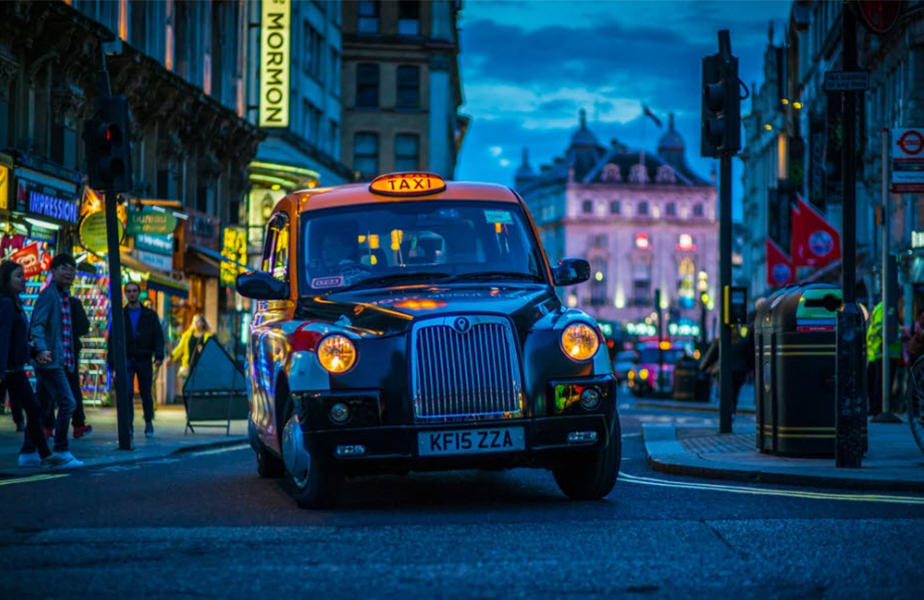 london taxi at night