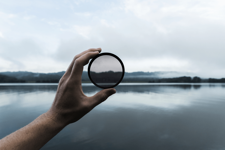 neutral density filter held in front of a landscape