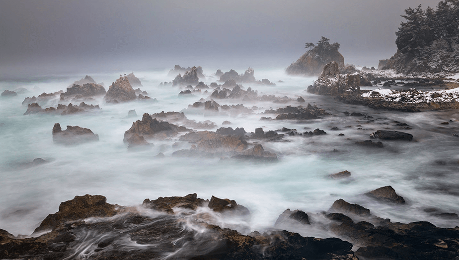 long exposure of winter seascape on rocky shore