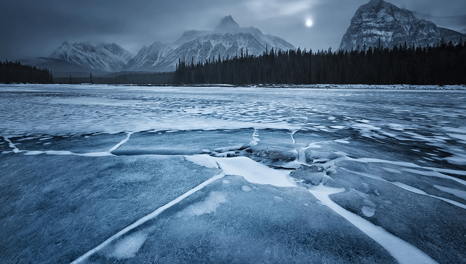 broken ice on frozen lake during foggy day